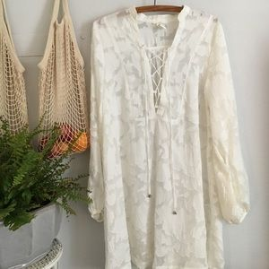 Sheer white lace up dress